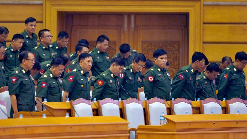 Members of the military, in uniform, standing in parliament on 24 March 2016.