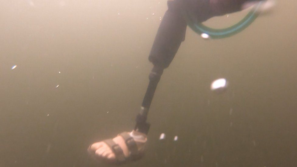 The prosthetic leg under the water
