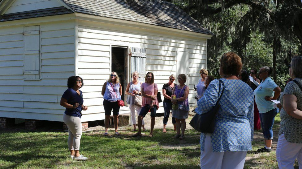 Olivia leading a tour in front of what used to be the kitchens where enslaved women worked