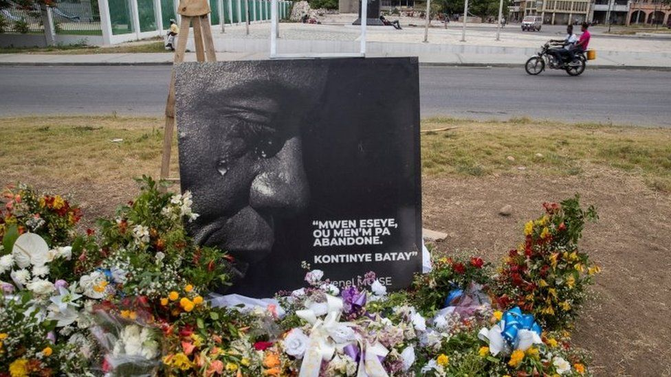 A view of an altar with flowers made as a tribute to President Jovenel Moise, assassinated a week ago at his home; in front of the National Palace in Port-au-Prince, Haiti, 14 July 2021