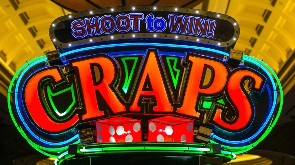 """An illuminated sign for the casino game """"craps"""" at Caesars Palace Hotel in Las Vegas, Nevada, 29 May 2017"""