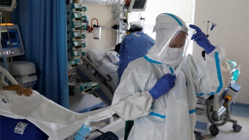Medical staff treat a patient inside of the extracorporeal membrane oxygenation (ECMO) coronavirus disease ward at the Interior and Administration Ministry (MSWiA) hospital in Warsaw