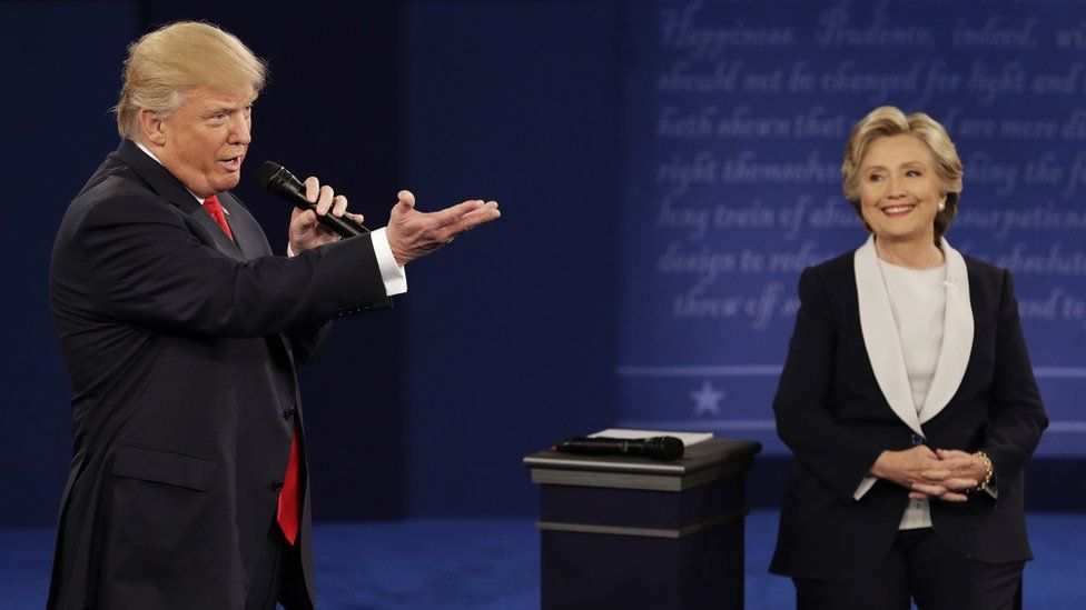 Republican presidential candidate Donald Trump speaks with Democratic opponent Hillary Clinton during the second presidential debate at Washington University in St Louis, 9 October 2016