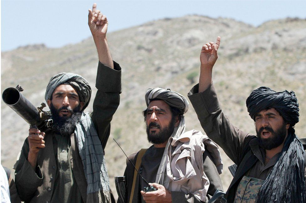 Taliban fighters carrying weapons cheers during a speech by their senior leader in the Shindand district of Herat province, Afghanistan. 27 May 2016.