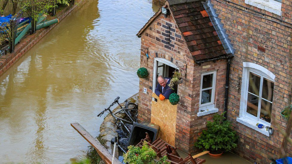 Flooding in Ironbridge, Shropshire, as residents in riverside properties in the area have been told to leave their homes and businesses immediately after temporary flood barriers were overwhelmed by water.
