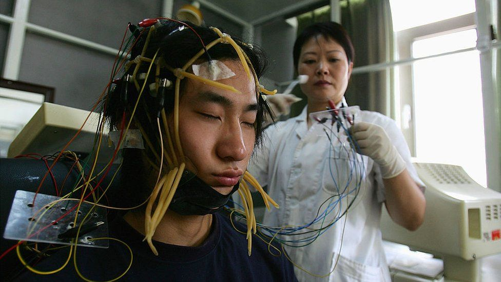 A young Chinese internet addict receives an electroencephalogram check at the Beijing Military Region Central Hospital 6 July 2005 in Beijing, China.