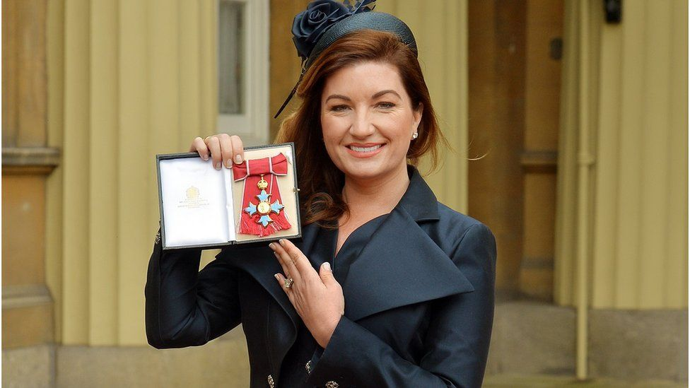 Karren Brady holds her CBE (Commander of the Order of the British Empire) presented to her by the Duke of Cambridge at an Investiture ceremony at Buckingham Palace in central London on March 18, 2014.