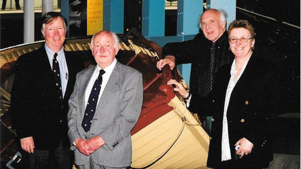 Sue (right) pictured with historians J Revell Carr and Anthony Smith and Ted Milburn, whose father died on the Anglo-Saxon