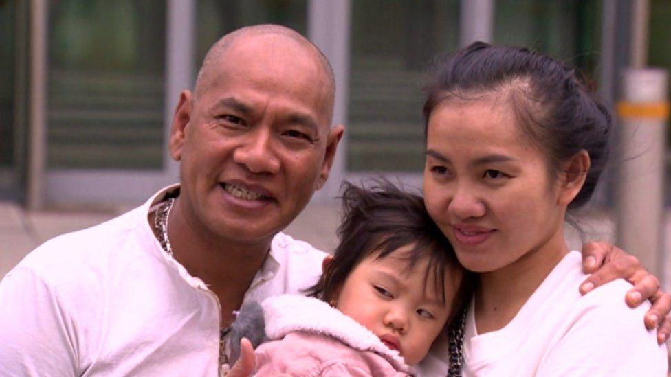 Vance McElhinney, his partner Le and baby Liz