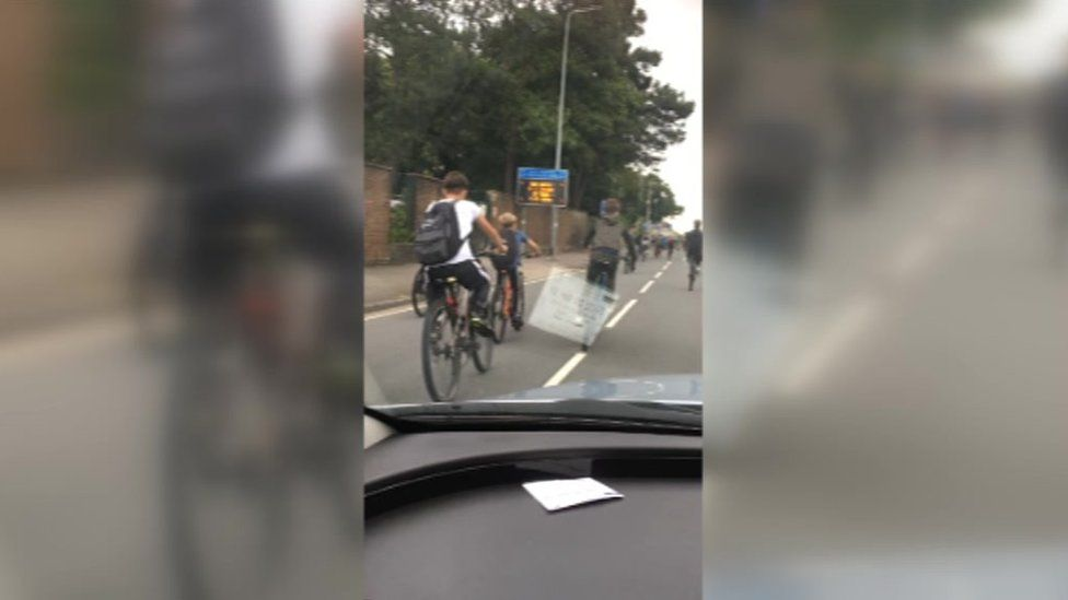 Group of cyclists in front of cars on North Road, Cardiff