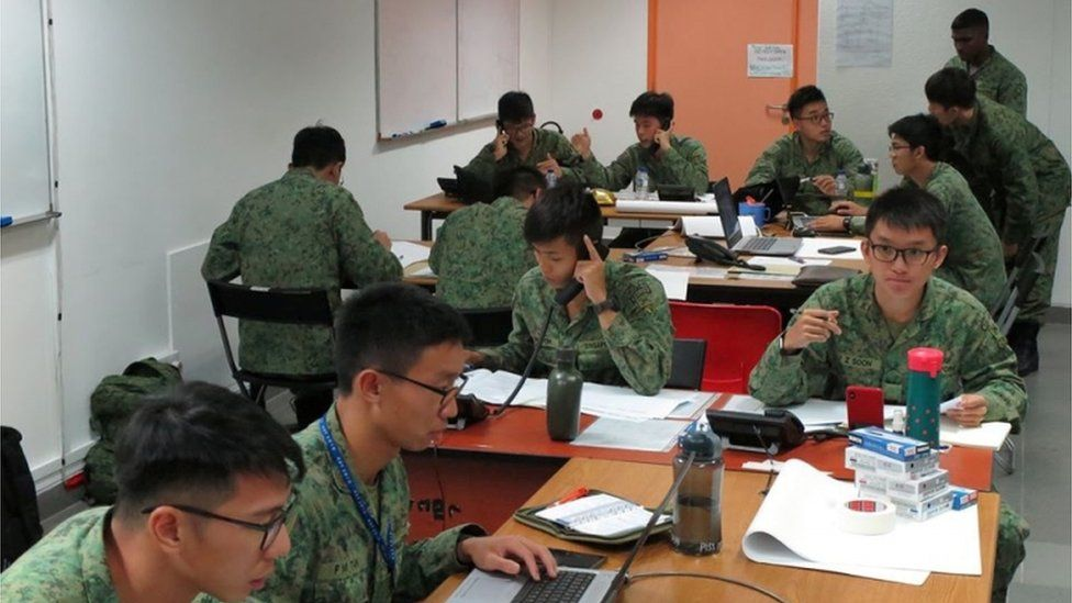Singapore Armed Forces personnel conduct contact tracing in efforts to prevent the spread of the Wuhan coronavirus, in Singapore, January 28, 2020