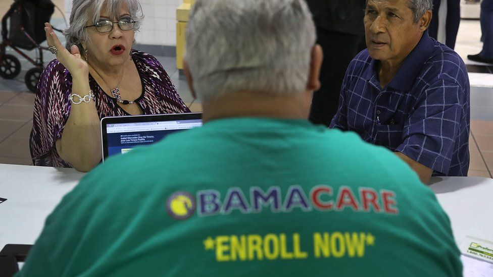 People sign up for health insurance in Miami, Florida. 1 November 2017