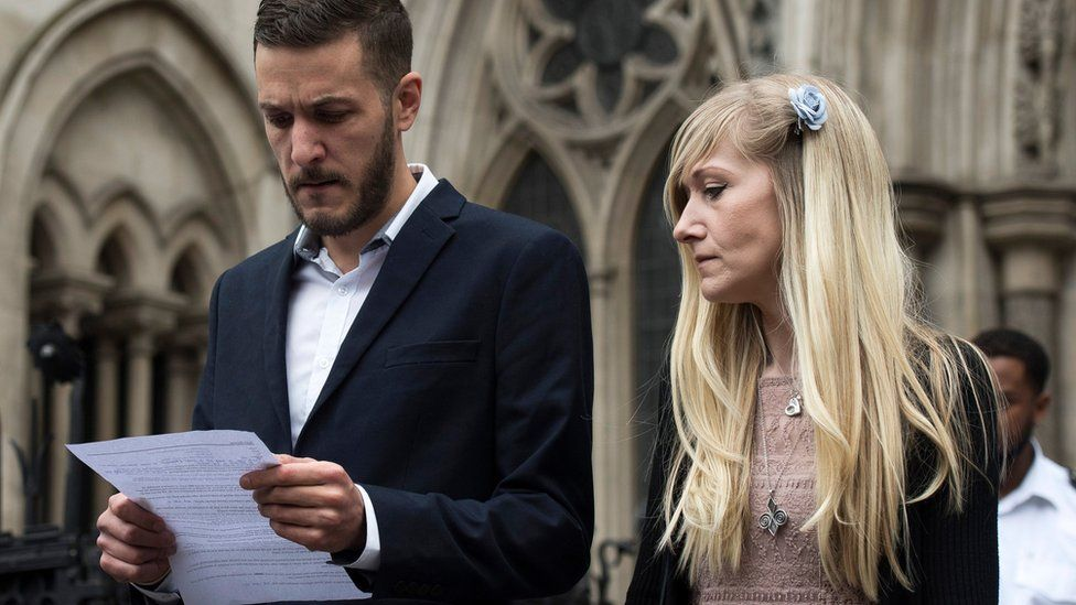Charlie's parents outside the High Court