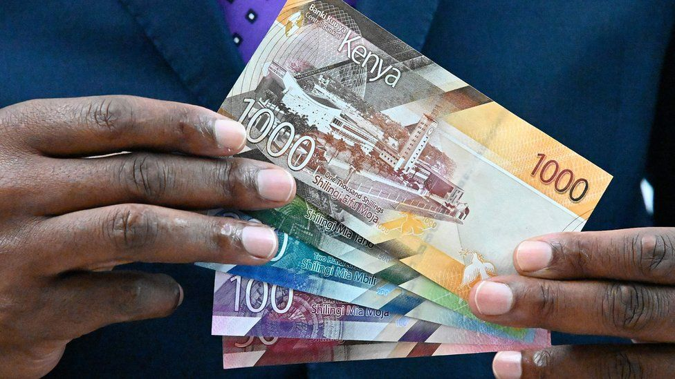 Patrick Njoroge displays some of the new designs for the Kenyan currency notes