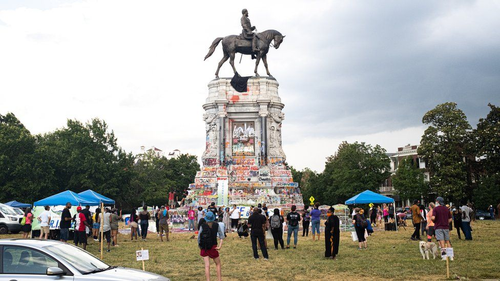 Protesters gather at a statue of Confederate Gen Robert E. Lee earlier this year