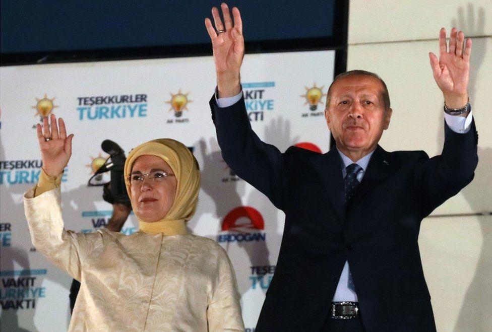 Turkey's President Recep Tayyip Erdogan and his wife Emine Erdogan greet supporters gathered at the AK Party headquarters in Ankara, Turkey
