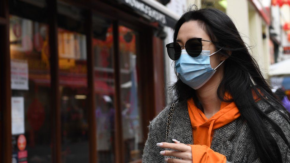 """A woman wears a face mask in Chinatown in London, Britain, 04 February 2020. London""""s Chinatown is feeling the impact of the Coronavirus as restaurants are seeing a down in customers following the confirmation of new coronavirus cases in the UK."""
