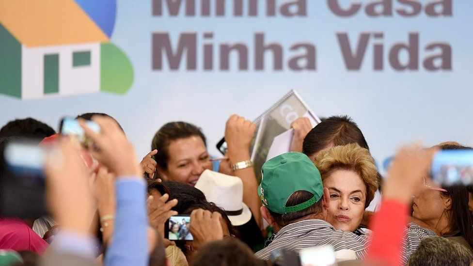 Dilma Rousseff (C-R) attends the launching ceremony of a new stage of the state-subsidized housing programme, May 6, 2016
