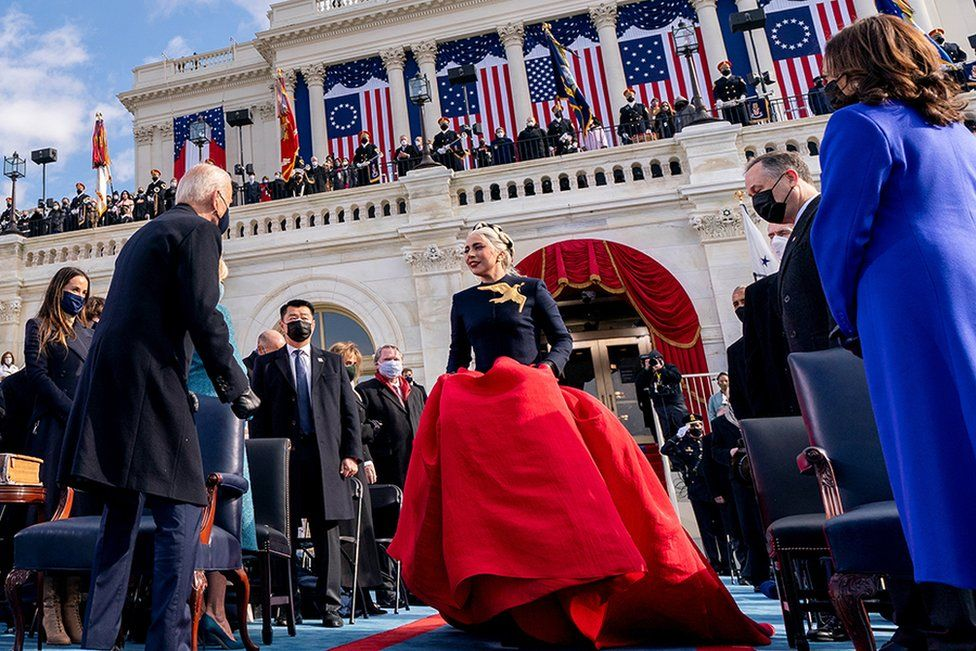 Lady Gaga arrives to perform the National Anthem as President-elect Joe Biden and Vice President-elect Kamala Harris watch during the 59th Presidential Inauguration at the U.S. Capitol, in Washington DC, 20 January 2021.