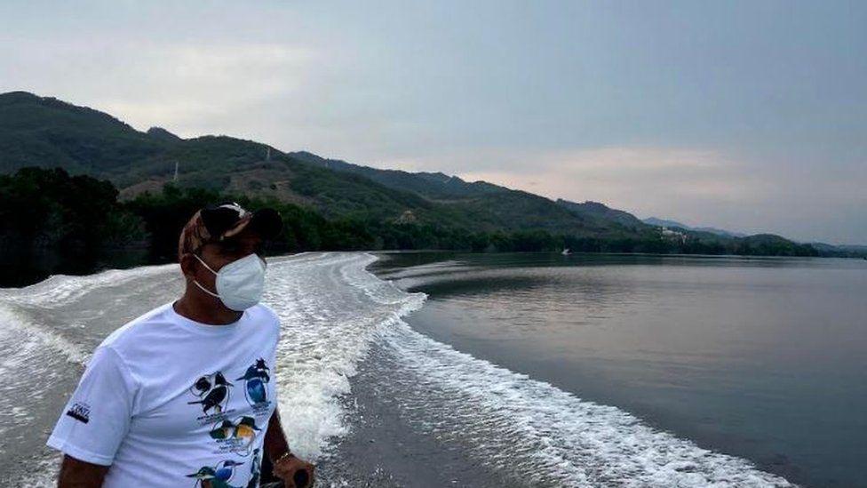 A local boatman, Lalo Escamilla, sails in Puerto Escondido