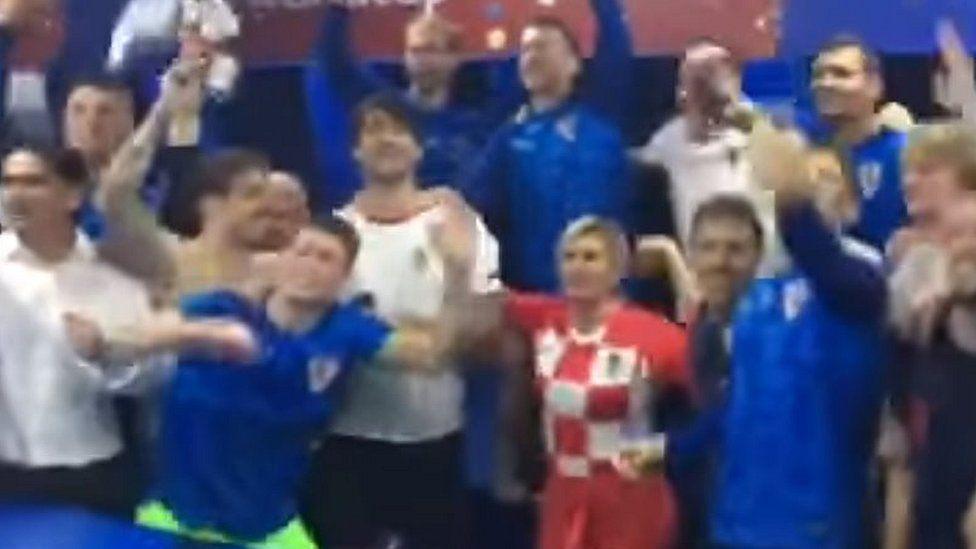 Croatia's president celebrates quarter final success in the team dressing room