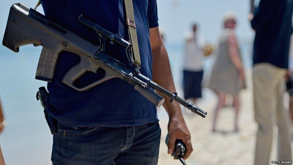 Armed policeman on Marhaba beach, Sousse, 28 June 2015