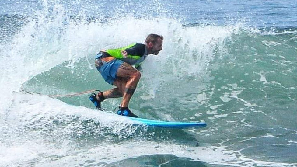 Pip Holmes surfing