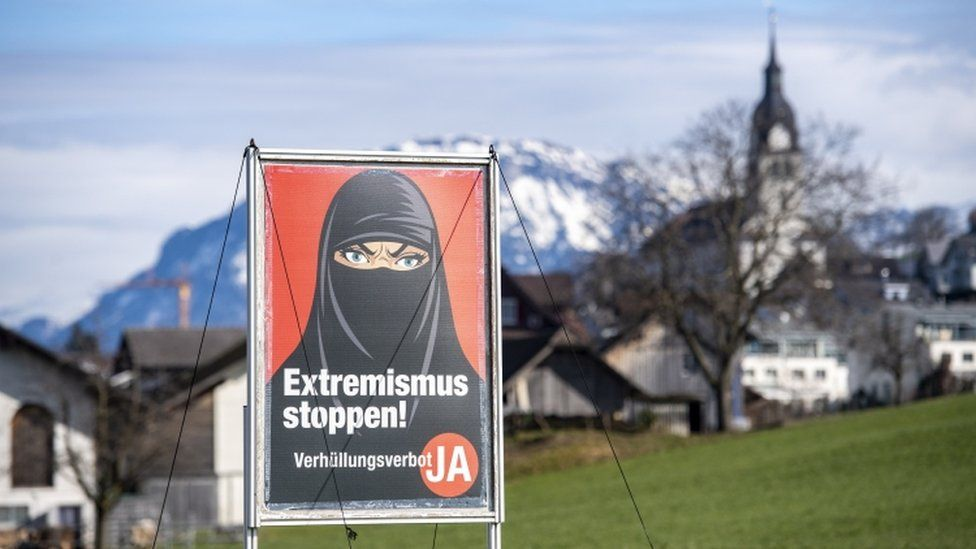"A poster promoting ""Yes to the burka ban"" is seen in Oberdorf, in the canton of Nidwalden, Switzerland, 16 February 2021"