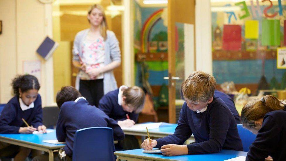 Primary pupils taking test
