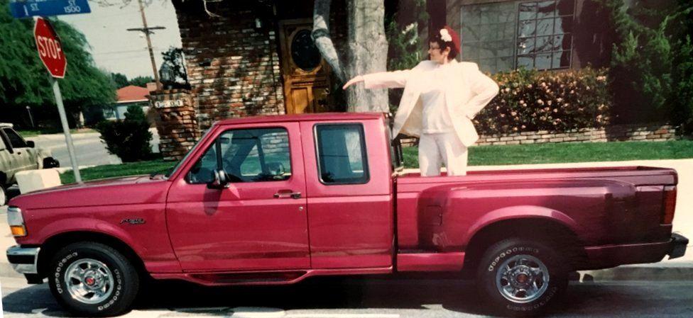 Cat Hulbert and her fuchsia pick-up truck