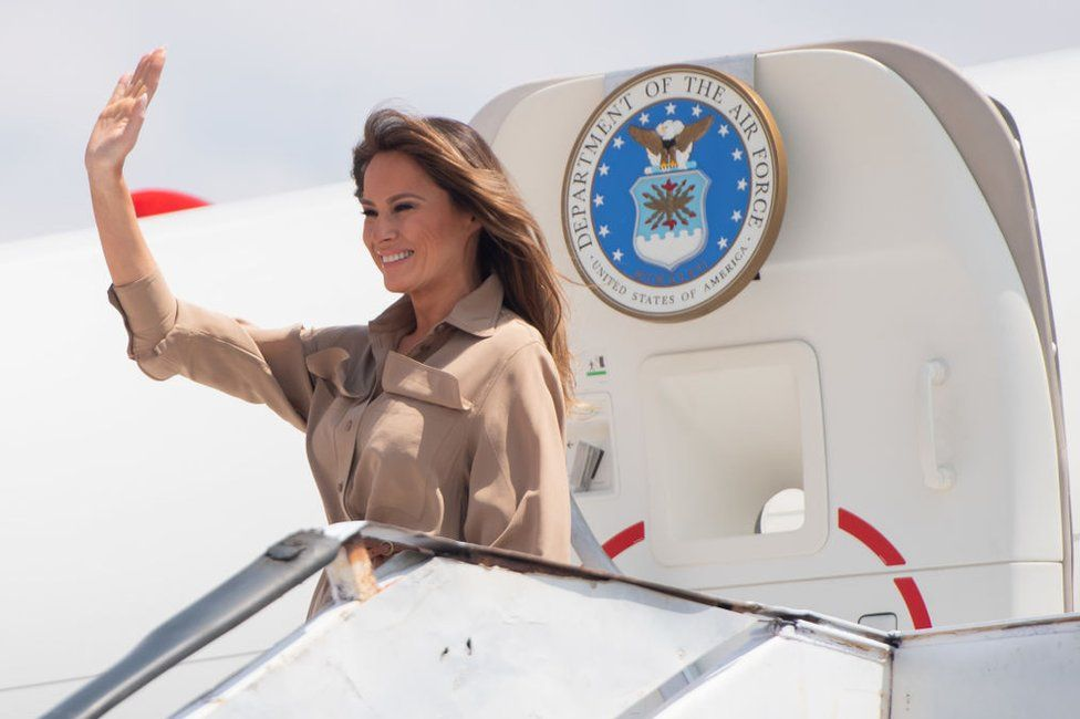 Melania Trump waves as she lands in Malawi
