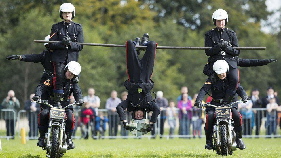 white helmet riders perform