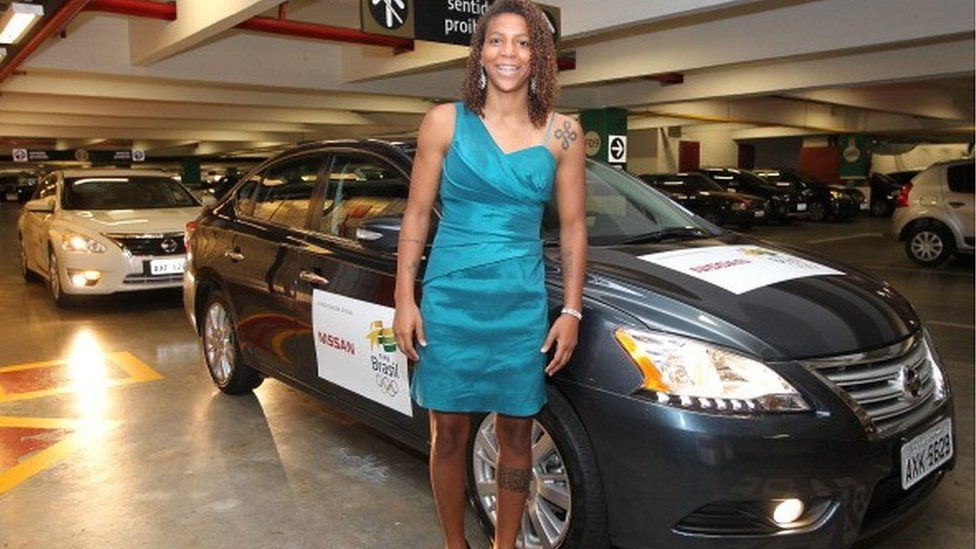 Rafaela Silva, Judo athlete, in front of a Nissan car with Olympic logos