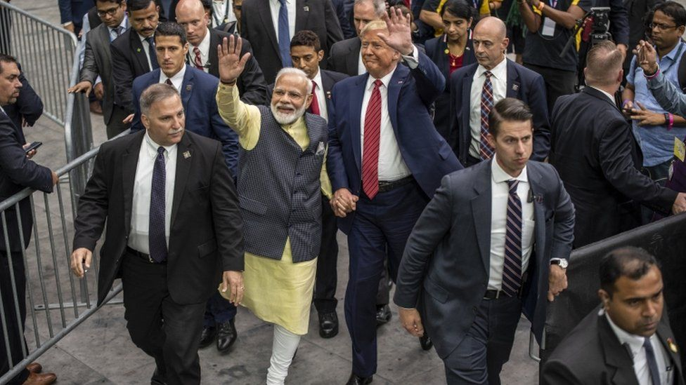 Narendra Modi and Donald Trump leave the stage holding hands at NRG Stadium, Houston