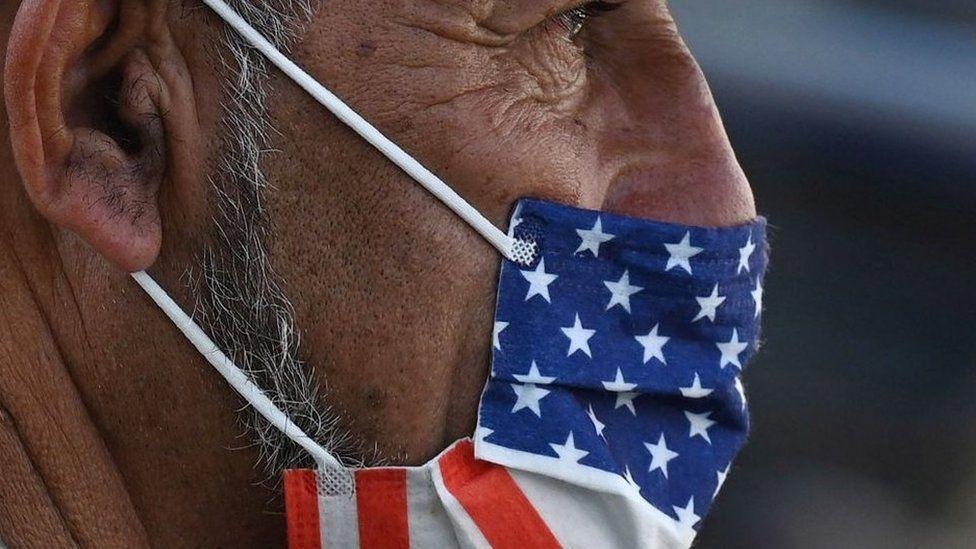 Man wearing US flag mask
