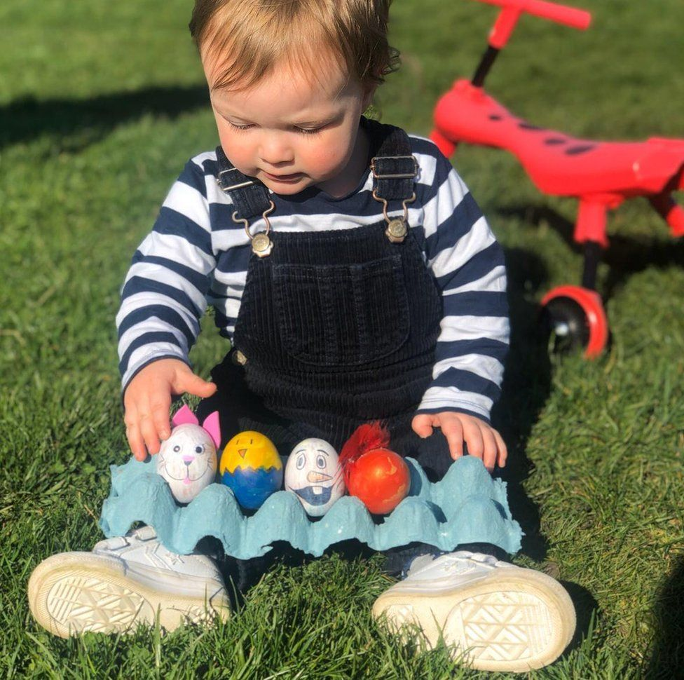 toddler with eggs