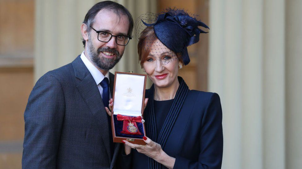 Neil Murray and JK Rowling after being made a Companion of Honour at Buckingham Palace in December 2017