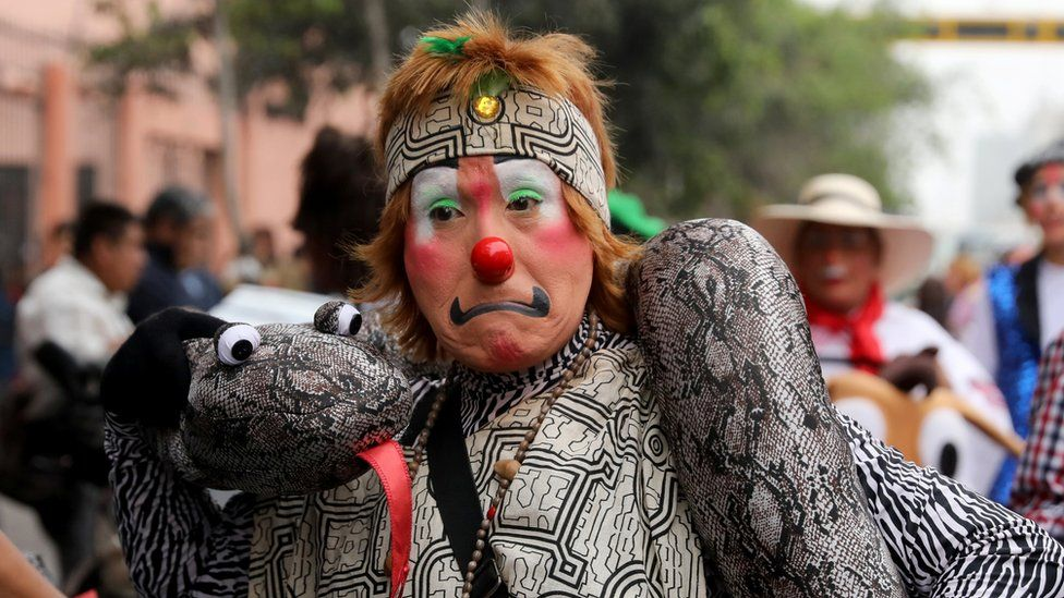 Clown takes part in a parade during Peru's Clown Day celebrations in Lima, Peru May 25, 2018