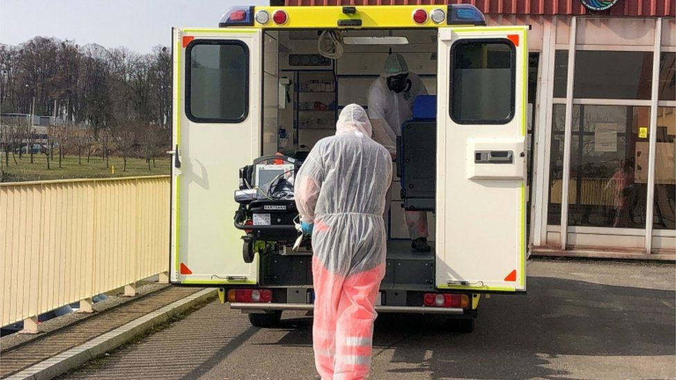 An ambulance brings a patient from the Czech Republic to neighbouring Poland