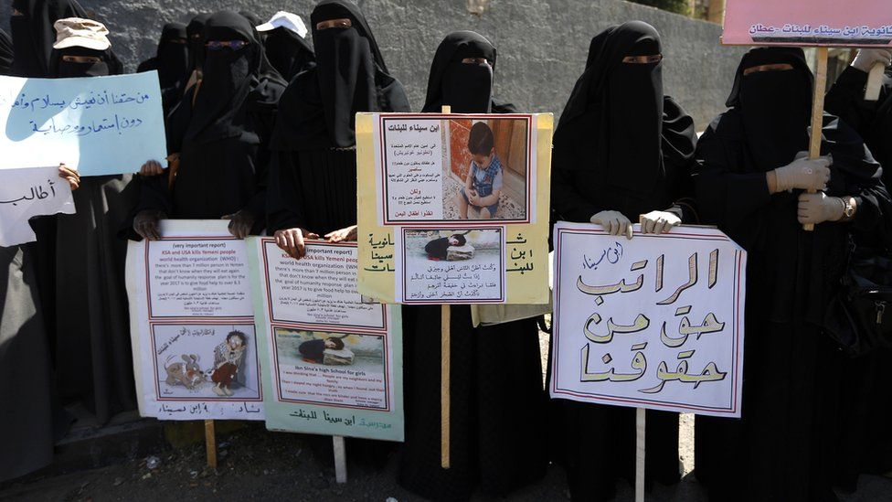 Yemeni female teachers and their children attend a protest against the conflict and the suspension of their monthly salaries, outside the UN offices in Sanaa, Yemen
