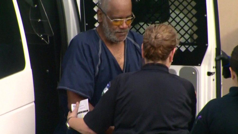 Truck driver James Mathew Bradley getting out of the police van, handcuffed