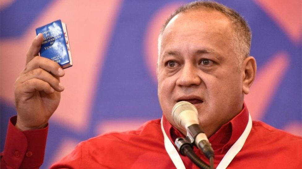Diosdado Cabello holds the Bolivarian Constitution of Venenzuela during a meeting on January 22, 2020 in Caracas, Venezuela