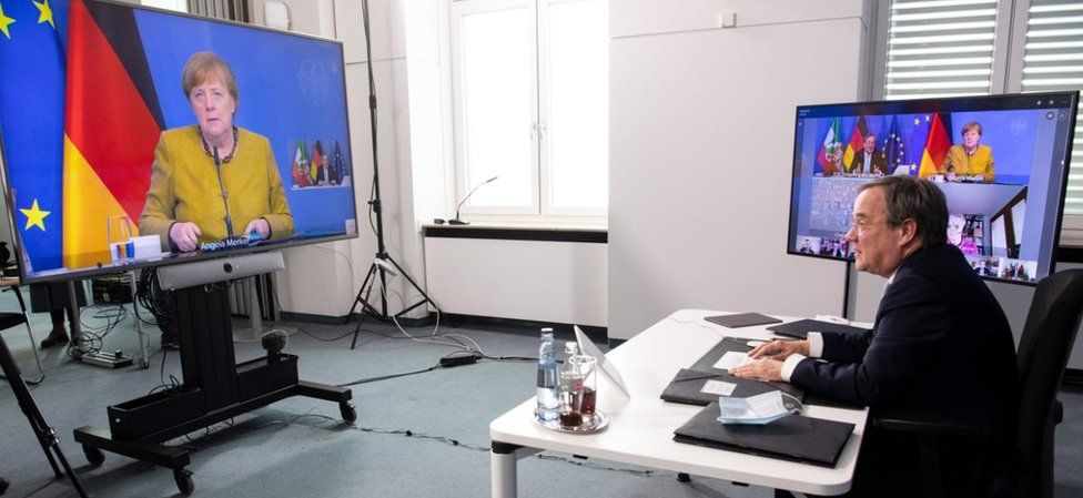Leader of the Christian Democratic Union (CDU) and North Rhine-Westphalia's State Premier Armin Laschet sits in front of monitors in the State Chancellery in Duesseldorf to chair the meeting of the Corona Council of Experts on February 26, 2021,