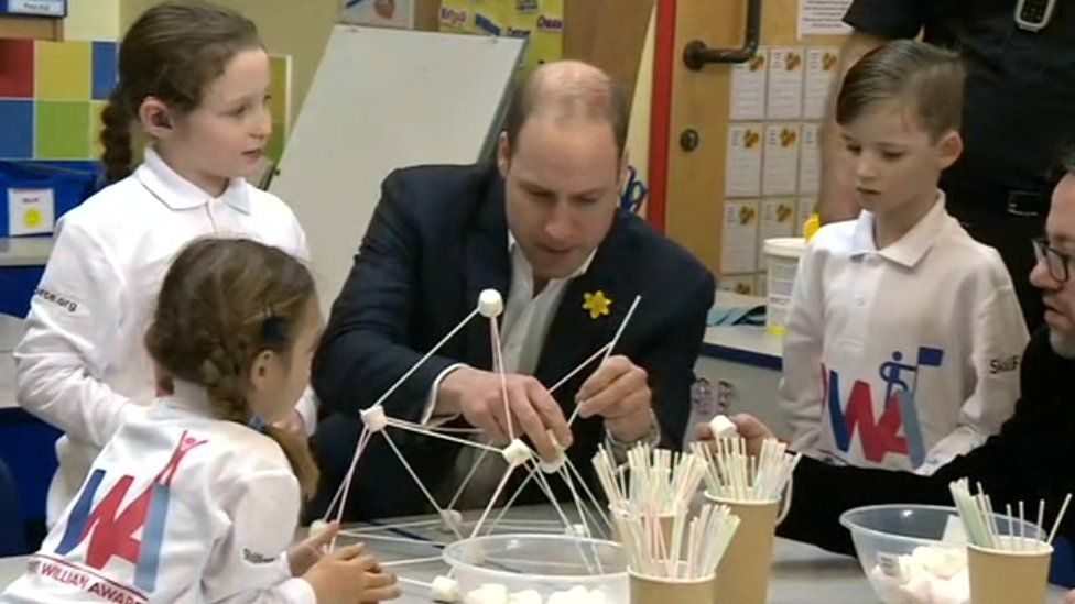 Prince William makes a free-standing marshmallow tower with pupils from Bishopstone Primary School in Swindon