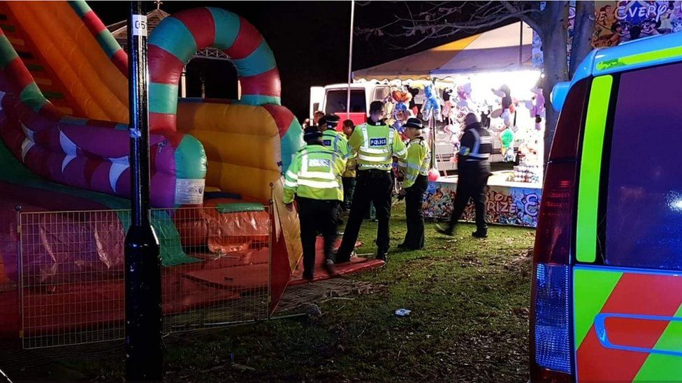 Police at the scene of the inflatable slide collapse