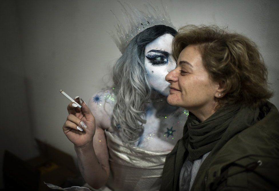 Elias kisses his mother Valerie on the cheek whilst he is dressed as drag queen Melanie Coxxx