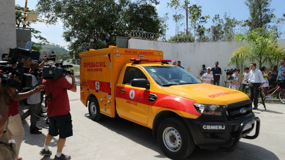 A civil defence vehicle transports a body after the fire in the training centre of Flamengo football club, in Rio de Janeiro, Brazil, 8 February 2019