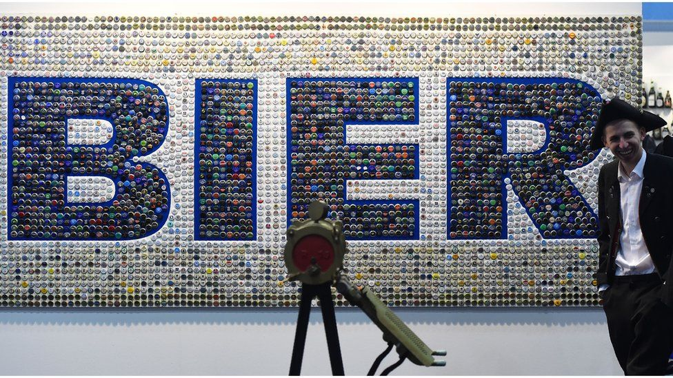 """""""Bier"""" (meaning beer) is spelled out in bottle tops on a wall at an agricultural fair in Berlin (15 January 2016)"""