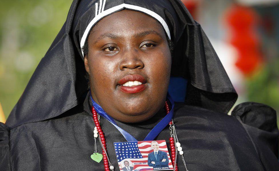A nun with a badge of Kenya opposition leader Raila Odinga and former US president Barack Obama - Kogelo, Kenya - Monday 16 July 2018