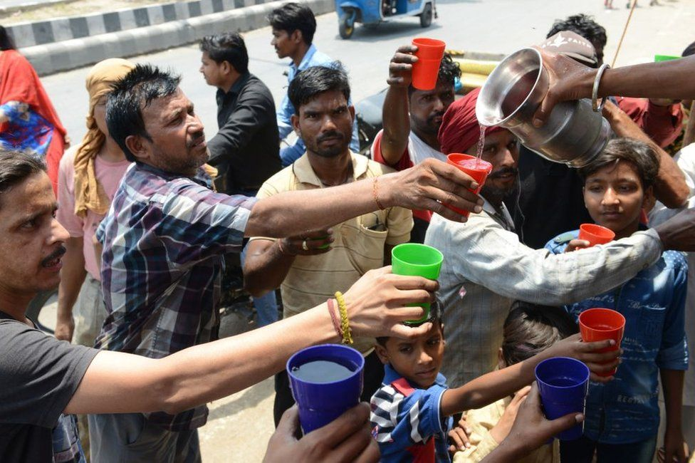 Indian volunteers distribute sweet water during a hot summer day, in Amritsar on June 2, 2019.